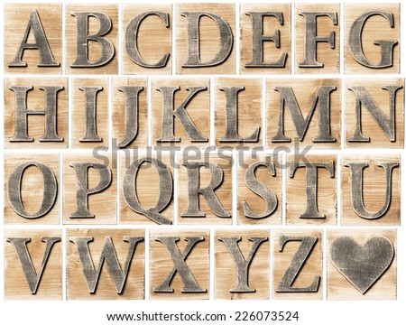 Wooden alphabet letter blocks isolated on white - stock photo