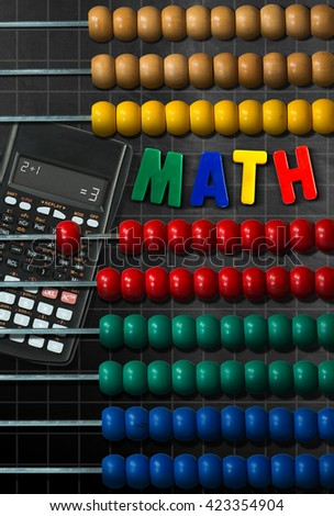 Wooden and colorful abacus and a modern calculator on a blackboard with a simple mathematical addition and text Math (magnetic letters) - stock photo
