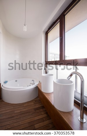 Wooden and very modern bathroom in the flat