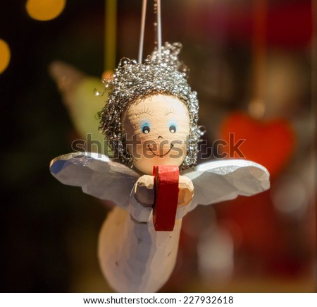 Wooden Angel, holding a heart as a Christmas ornament  - stock photo
