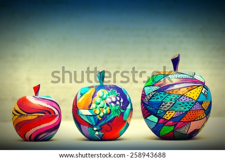 Wooden apples painted by hand. Handmade, contemporary art. - stock photo