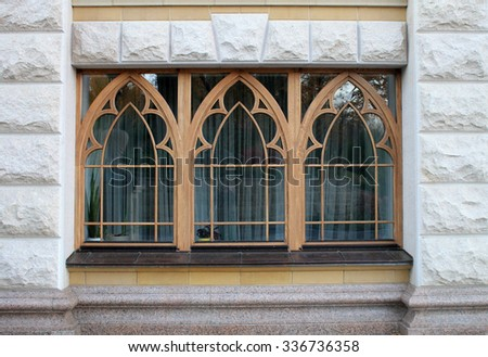 wooden arch windows of the stone house - stock photo