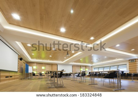 wooden architecture of modern conference room with cahirs and tables - stock photo