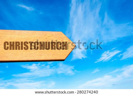 Wooden arrow sign pointing destination CHRISTCHURCH, NEW ZEALAND  against clear blue sky with copy space available. Travel destination concept  image - stock photo