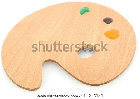 Wooden Art Palette with Paint - stock photo