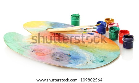 wooden art palette with paint and brushes isolated on white - stock photo