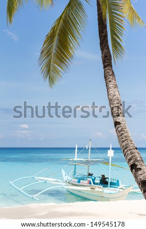 Wooden asian boat on tropical beach with palm and white sand, Philippines, Boracay - stock photo