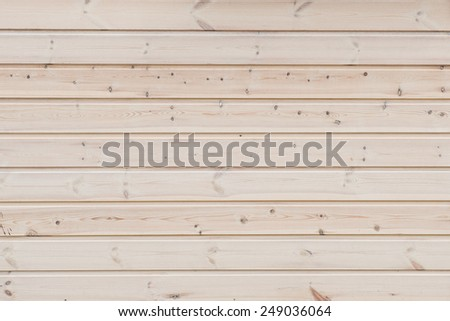 wooden background - horizontally stacked pine boards - stock photo