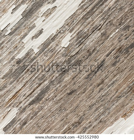 wooden background of weathered distressed rustic wood with faded white paint showing wood texture. - stock photo