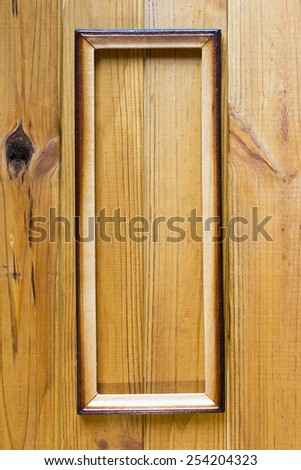 Wooden background with a frame for a picture.