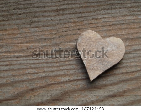 wooden background with a heart - stock photo