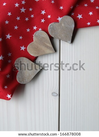 wooden background with fabric, stars and hearts - stock photo