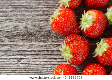 wooden background with fresh strawberries, close-up, top view - stock photo