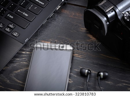 Wooden background with gadgets