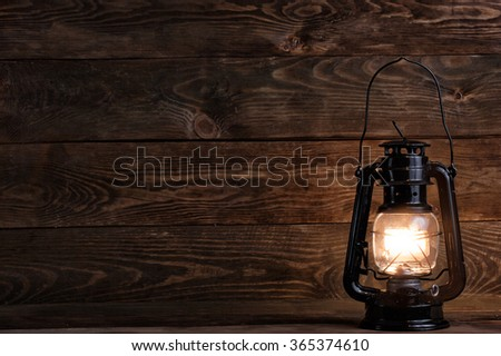 Wooden background with gas lamp - stock photo