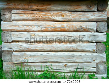 wooden background with green grass - stock photo