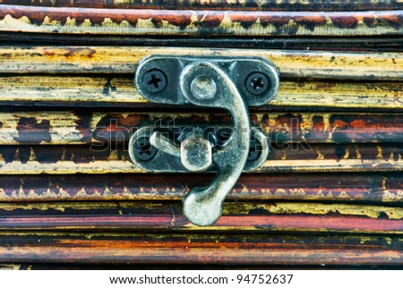 Wooden background with little iron hasp - stock photo