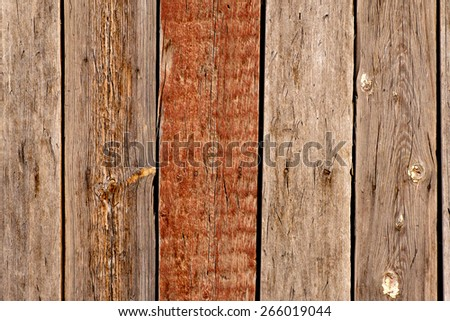 Wooden background with one painted in brown plank - stock photo
