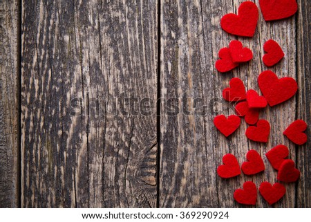 Wooden background with red hearts on Valentine's day.
