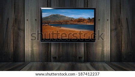 wooden background with tv and Australian landscape