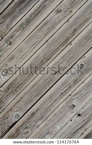 Wooden background with weathered wood and rusty nails. - stock photo