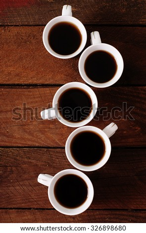 Wooden background with white cup of coffee - stock photo