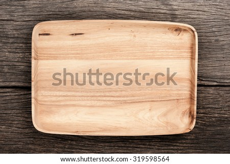 wooden background, wooden tray on wooden table - stock photo