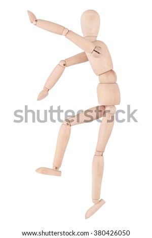 Wooden ball-jointed doll climbs up, isolated on white background - stock photo