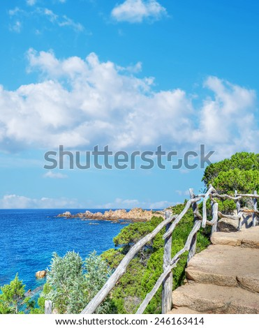 wooden banister by the sea. Processed for hdr tone mapping effect. Shot in Costa Paradiso, Italy. - stock photo