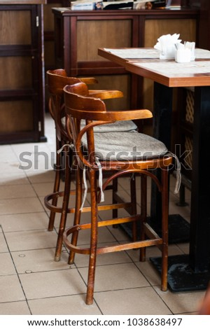 Wooden bar stools and table in the cafe.