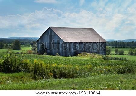 Wooden barn Farm landscape, Quebec, Canada  - stock photo