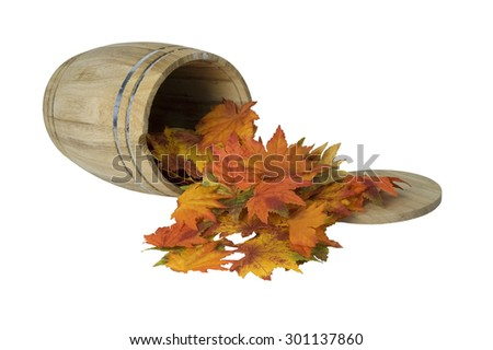 Wooden barrel with metal bands on side with fall leaves - path included - stock photo