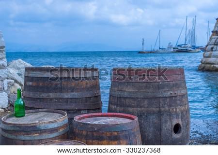 Wooden barrels on the harbor Corfu Greece - stock photo