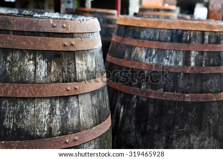 wooden barrels outside a brewery - stock photo