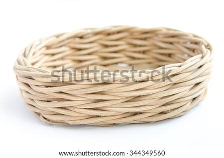 wooden basket on white background - stock photo