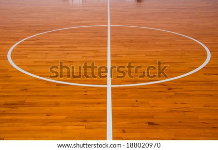 Wooden basketball court at center - stock photo