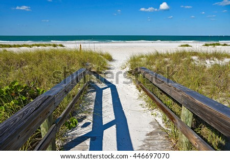 Wooden Beach Boardwalk leading to the white sandy Beach on Anna Maria Island - stock photo