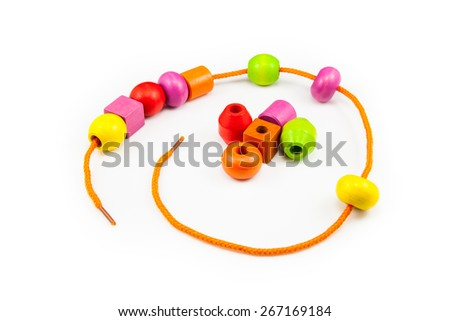 Wooden Beads on a String making a Colorful Toy Necklace - stock photo