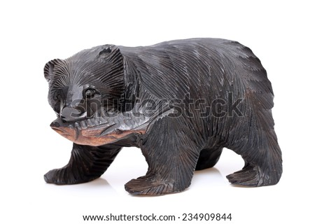 Wooden bear. Traditional Japanese souvenir, carved wood, white background - stock photo