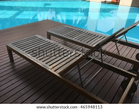 Wooden Bed Beside The Swimming Pool.