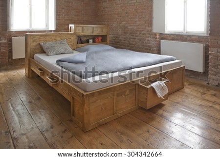 wooden bed with drawer - stock photo