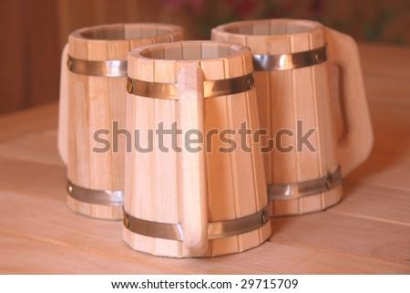 Wooden beer mugs - stock photo