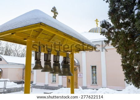 Wooden belfry with bells of orthodox church of Intercession, Moscow region, Russia  - stock photo