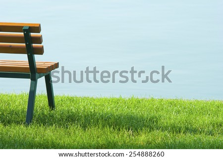 wooden bench at waterfront  - stock photo