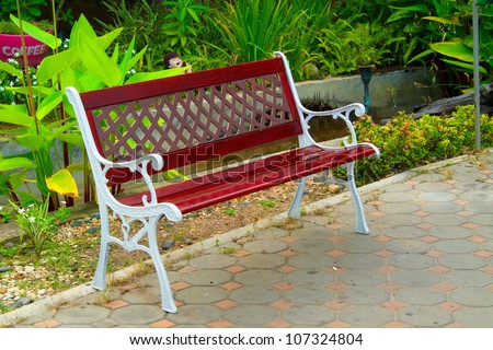 Wooden bench beside green - stock photo