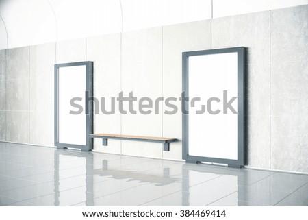 Wooden bench between blank billboards in empty hall with concrete floor, mock up,  - stock photo