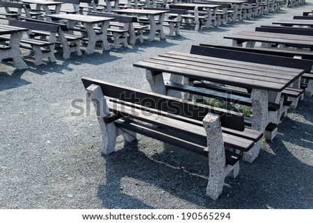 wooden bench in open air restaurant - stock photo