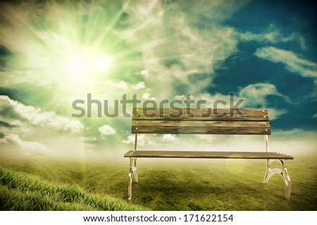 Wooden bench in the Field - stock photo