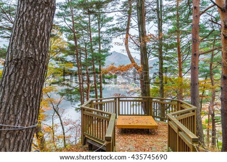 Wooden bench in the park - stock photo