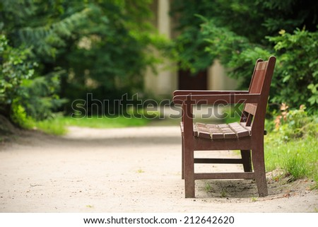 Wooden bench in the park in summer.Park Arkadia,Nieborow. - stock photo